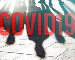 "The word ""COVID19"" in red block letters across a background of shadows of people."
