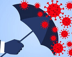 An illustration of the concept of a hand holding an umbrella to keep virus particles away.