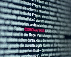 "A close-up of text on a display screen with the word ""coronavirus"" highlighted in red."